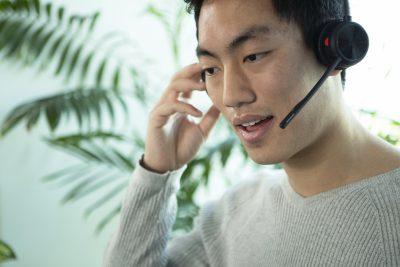 Man talking on Savi 7200 headset